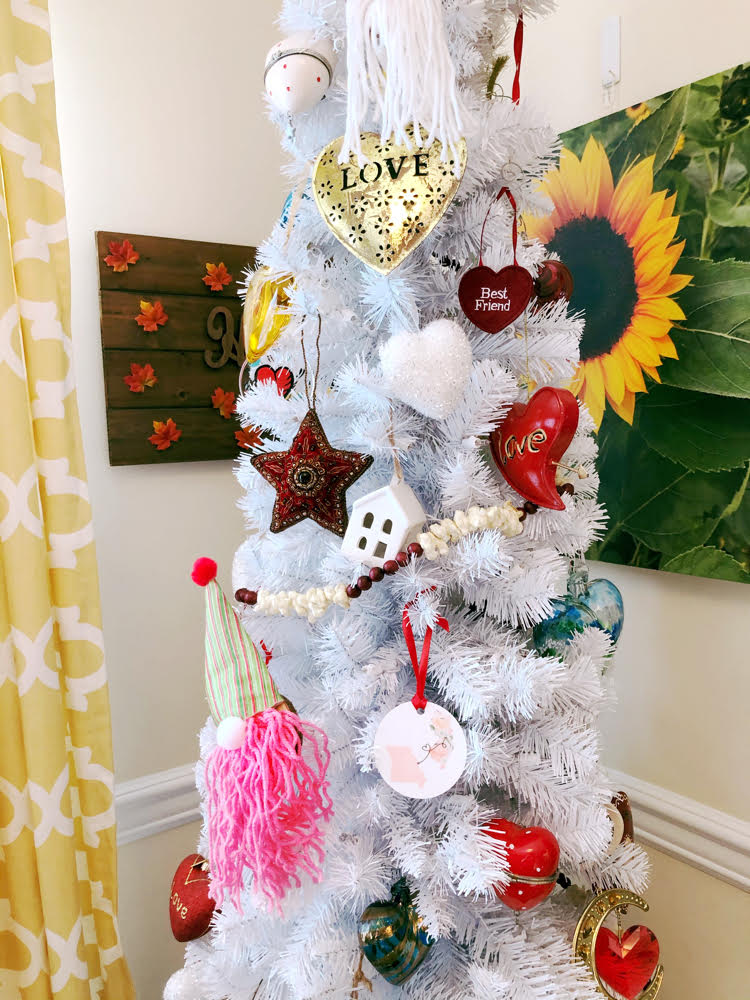 A white Christmas tree decorated for Valentine's Day