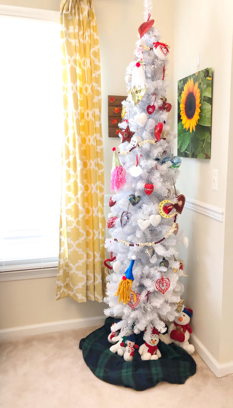 A white Valentine's Day tree decorated with heart ornaments