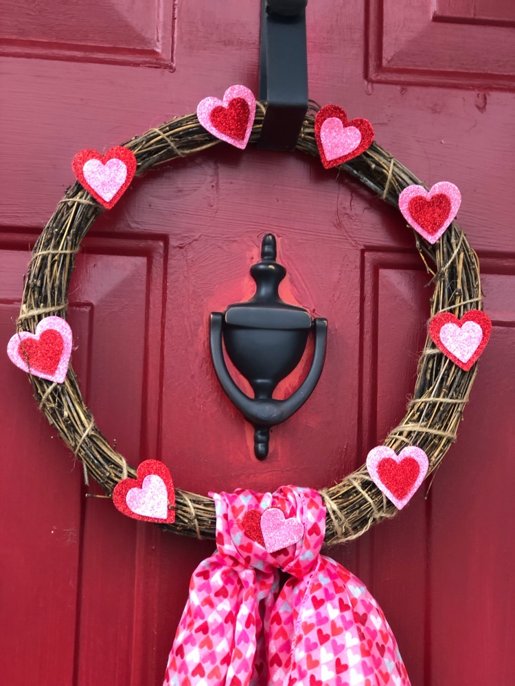 Make this sweet Valentine's Day wreath with less than $4 of dollar store craft supplies.
