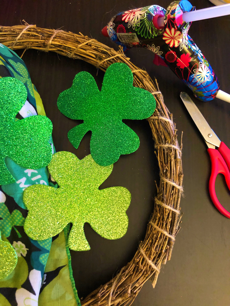 You just need a few dollar store supplies for this dollar store wreath for St. Patick's Day