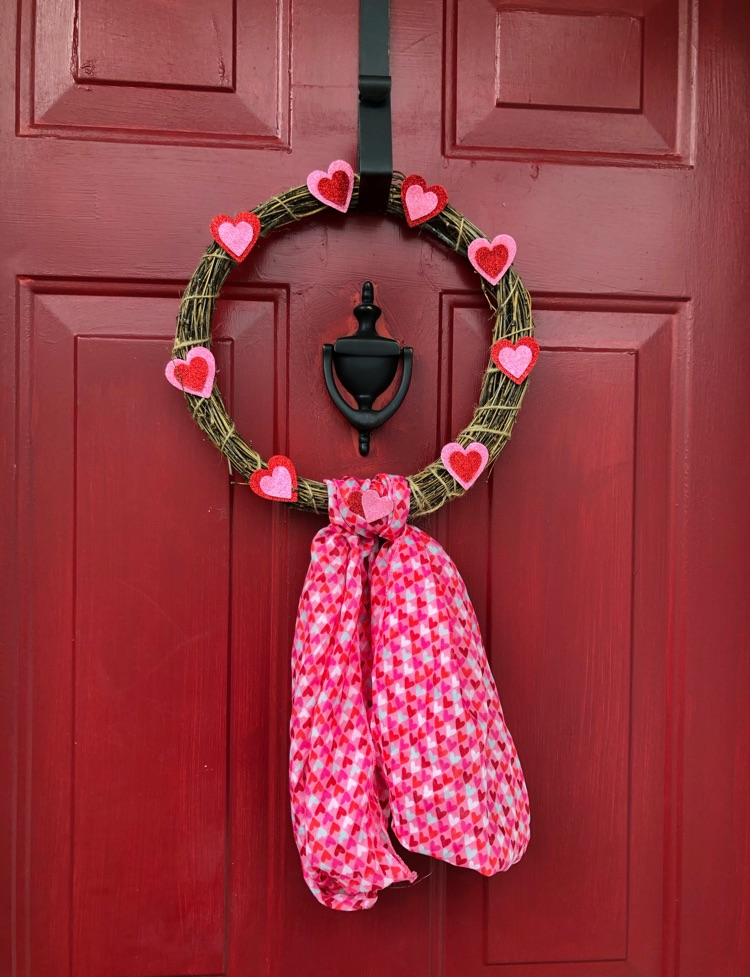 Make an adorable Valentine's Day wreath with only about $3 in supplies from the dollar store.