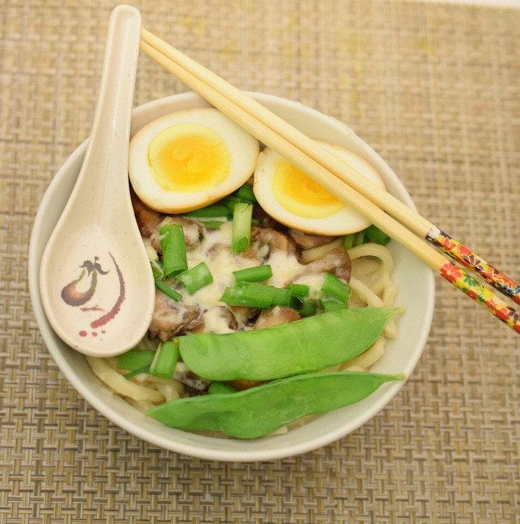 I love this easy recipe for mushroom udon noodle soup topped with a cheesy sauce and a soy egg.