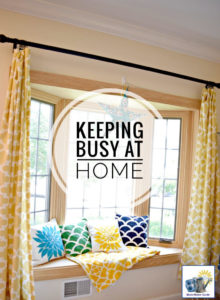 beautiful bay window with a colorful throw and pillows