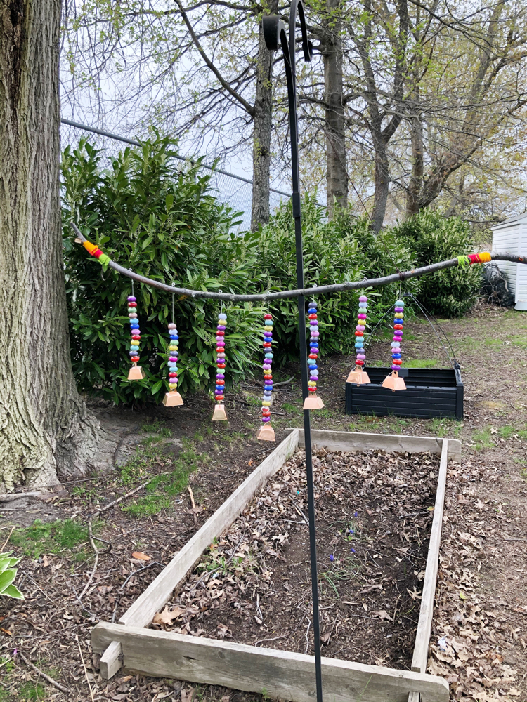 This colorful beaded wind chime is easy to make with materials you can ind at home