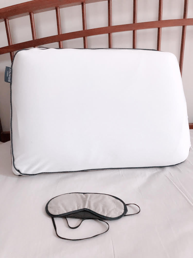 A farmhouse style bed, cooling memory foam pillow and night mask.