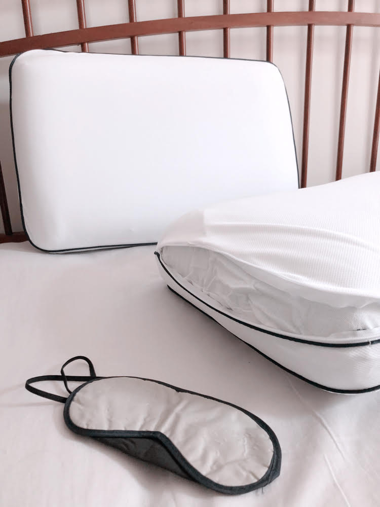 A cooling memory foam pillow with a removable and washable cover, and a night mask.