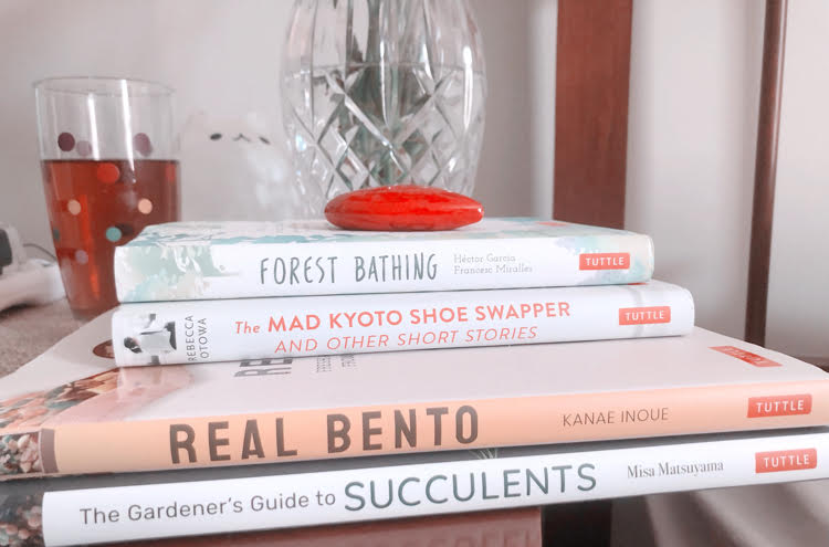 Books Forest Bathing, The Mad Kyoto Shoe Swapper, Real Bento, and The Gardener's Guide to Succulents on a nightstand. All books are by Tuttle Publishing.