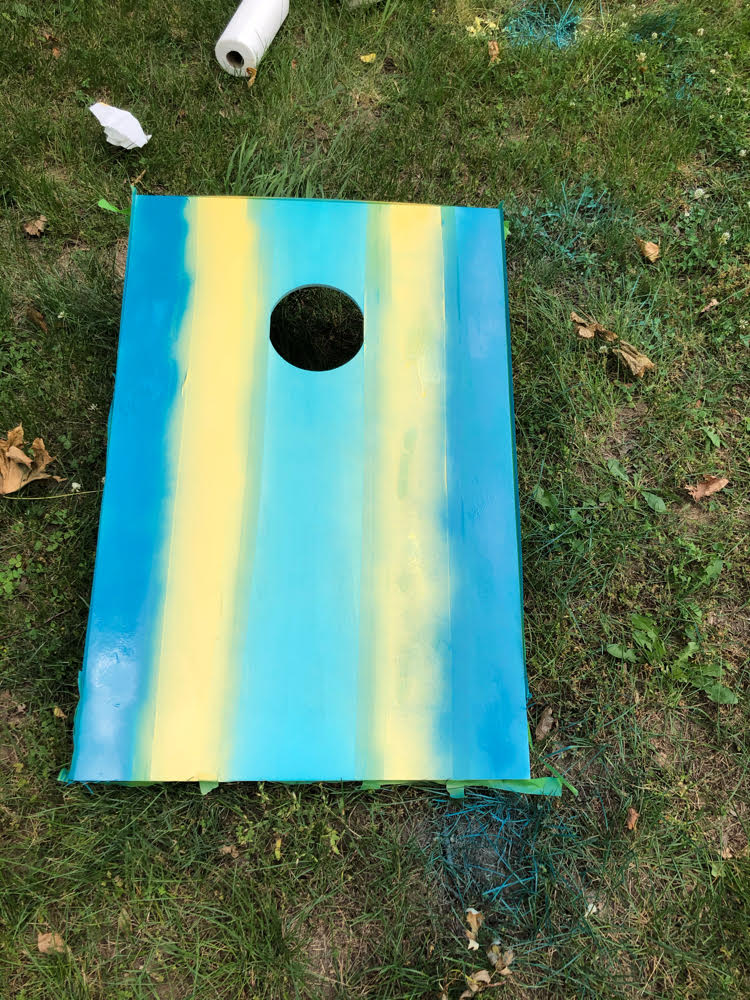 diy spray painted stripes on corn hole board