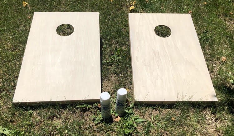 Spray paint makes it easy to have DIY painted corn hole boards. With just a little painter's tape, you can easily paint stripes on corn hole boards.