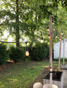 string lights hung from DIY planter posts