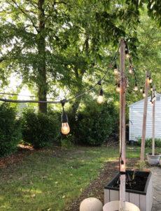 string lights hung from DIY planter posts
