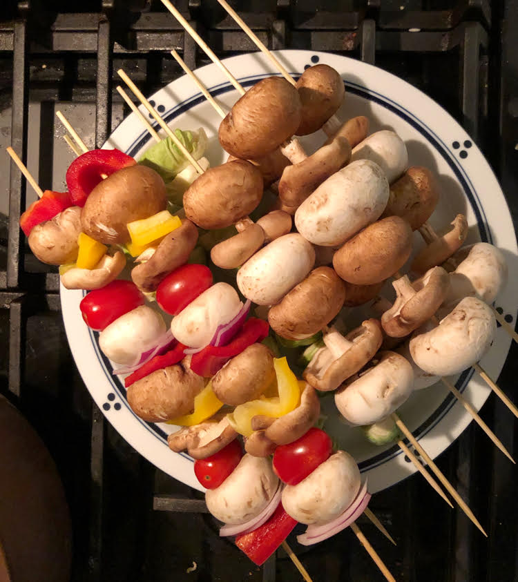 Mushroom, onion and pepper kebabs for cooking over a fire pit or grill.