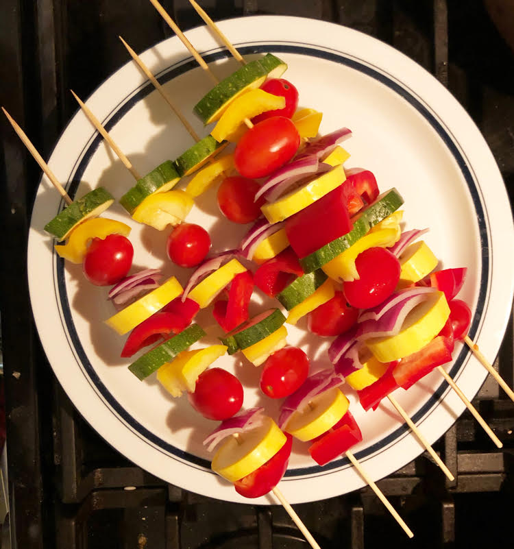 Zucchini, onion and tomato kabobs for a grill or a fire pit.