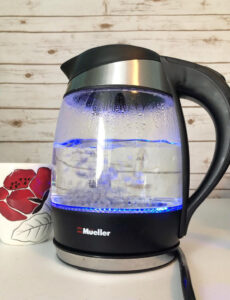 blue lit electric tea kettle