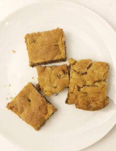 4 chocolate chip cookie bar cookies on a white plate