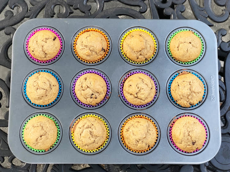 Banana muffins in colorful silicone liners in a muffin tin