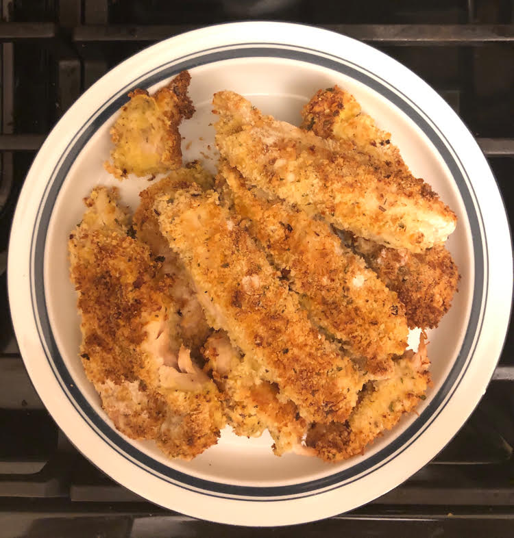 plate of air fryer chicken with a crisp seasoned coating