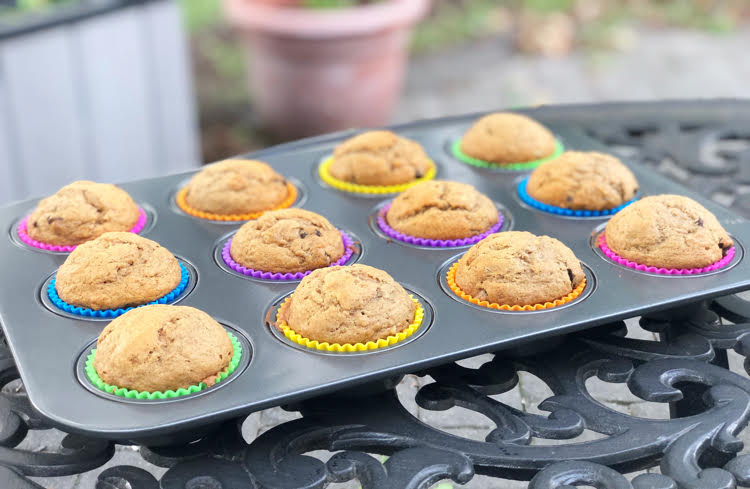 muffins in colorful silicone cupcake liners in a muffin tin