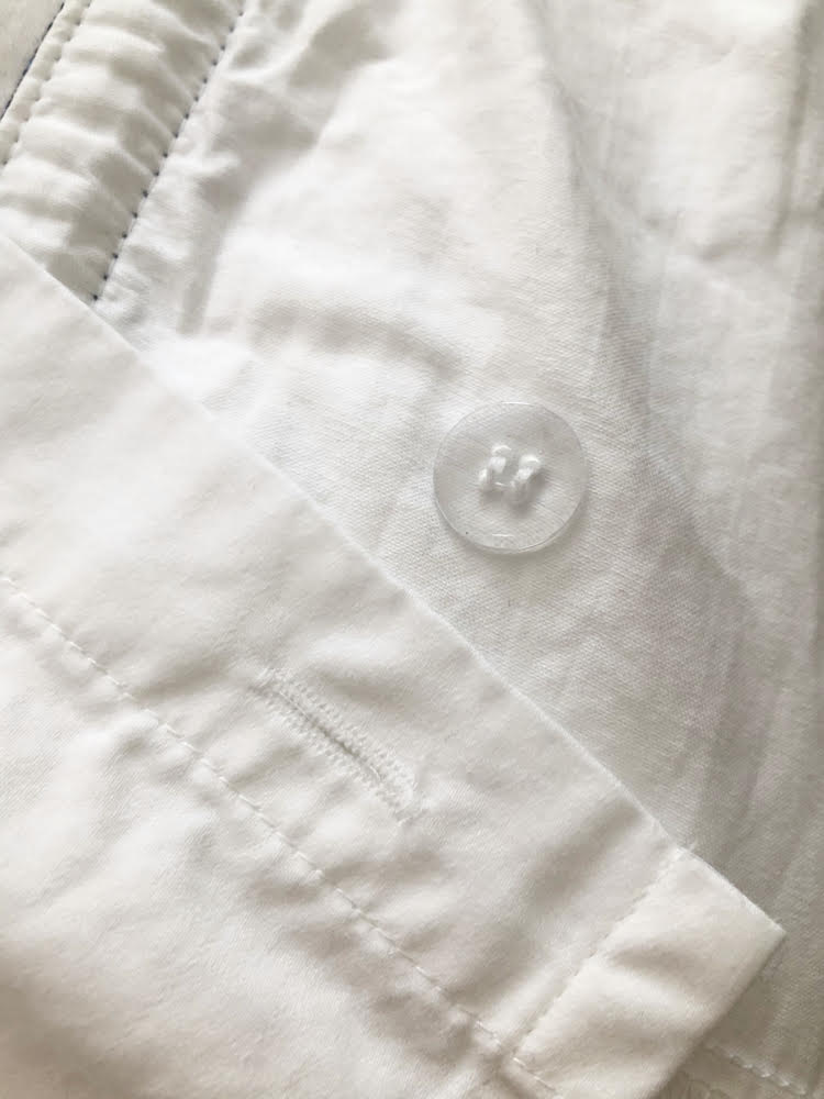 Button on Therapedic fitted sheet to secure flat sheet in place