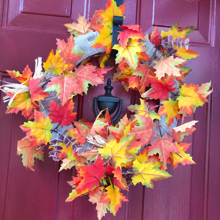 colorful burlap and faux fall wreaths wreath on a red door