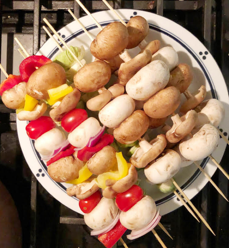 tomato, mushroom, tomato and onion skewers for cooking over a fire pit