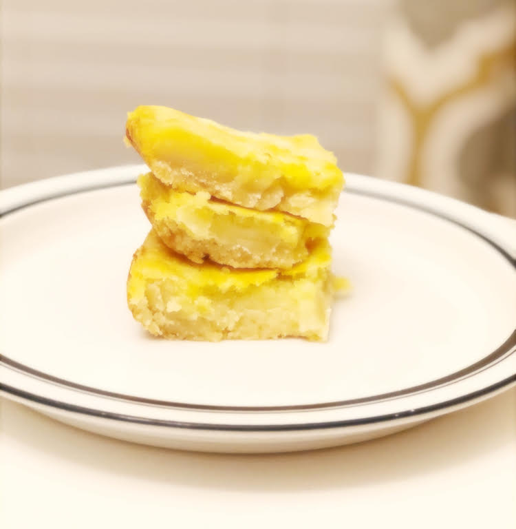 stack of delicious lemon shortbread cookie bars
