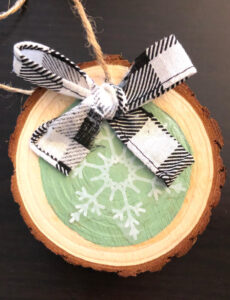 diy snowflake wood slice ornament with a buffalo plaid ribbon