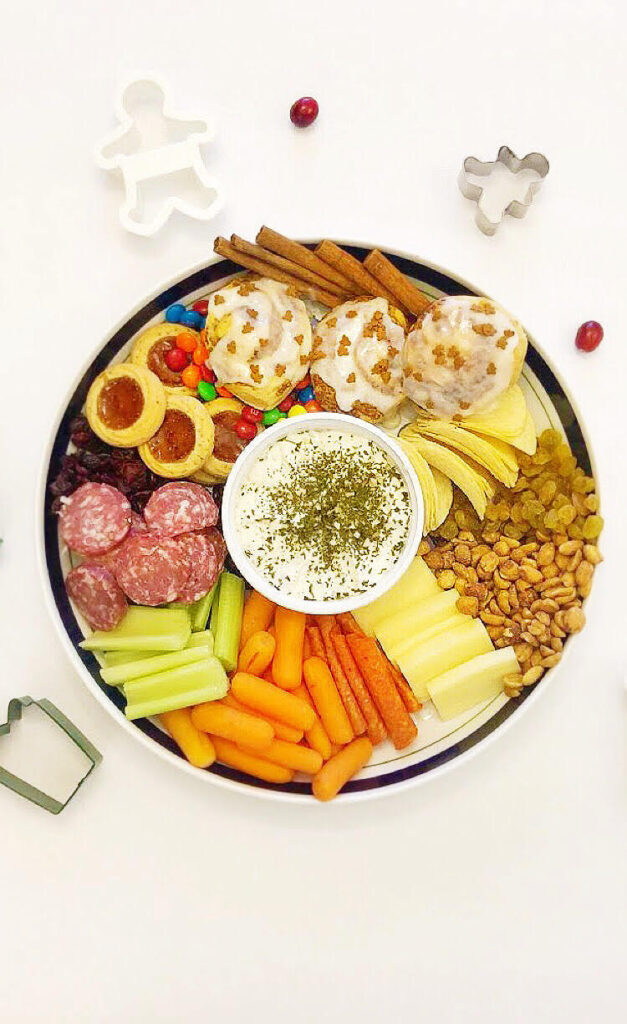 Christmas charcuterie tree with sweets, cheeses, meats and veggies