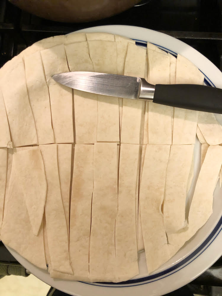 tortillas cut into strips with a a knife