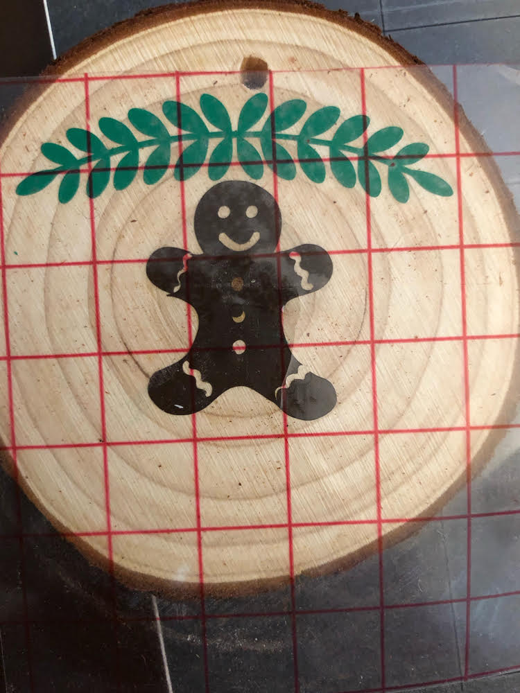 how to transfer a Silhouette cut vinyl design with transfer tape to a wood slice ornament