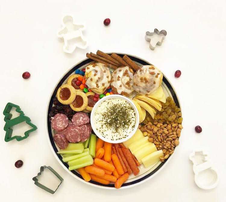 charcuterie board or snack tray for Christmas with cookies, cheeses, meats, snacks and veggies