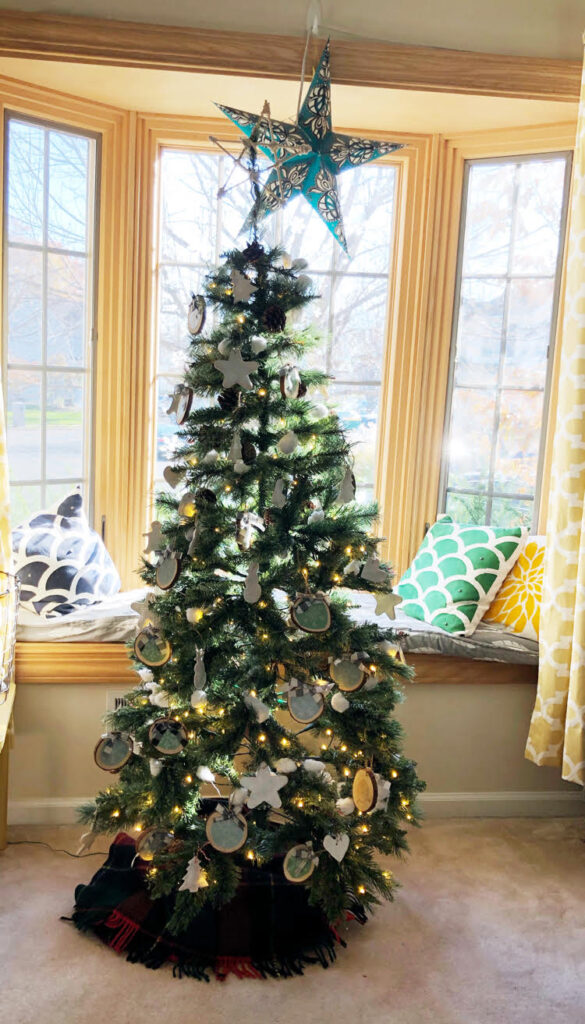 beautiful rustic tree decorated with DIY wood slices and salt dough ornaments
