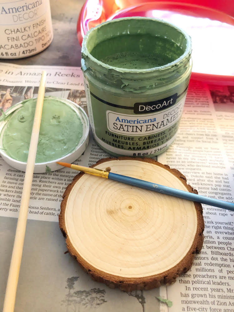 painting a wood slice Christmas ornament