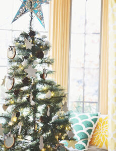 rustic chirstmas tree decorated with wood slice ornaments and salt dough ornaments