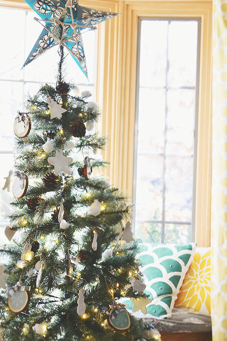 This artificial Christmas tree from Nearly Natural is decorated with pine cones, salt dough ornaments and tree slice ornaments.