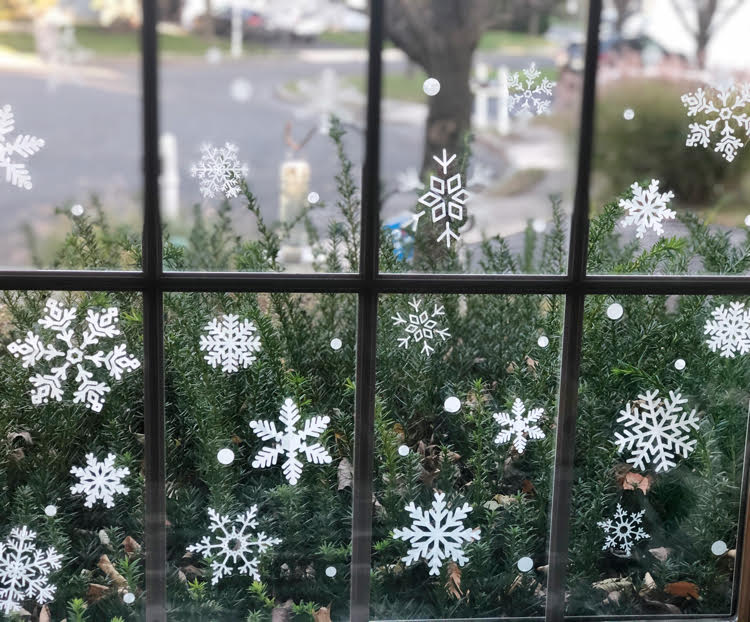 pretty vinyl snowflake decals in a paned window