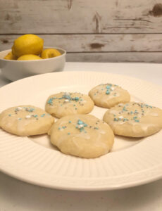 delicious frosted lemon shortbread cookies on a white p[late
