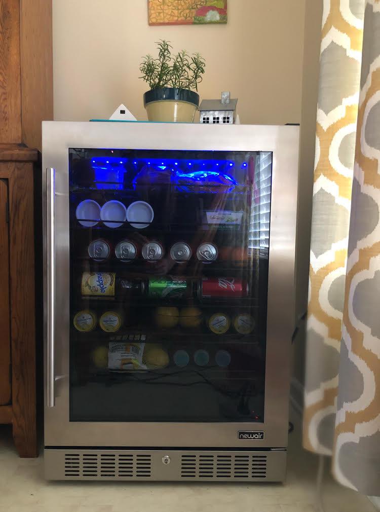 modern beverage fridge with LED lights