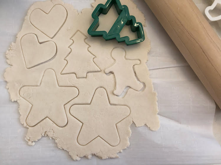 cutting shapes with a cookie cutter for pretty salt dough ornaments for Christmas and the holidays