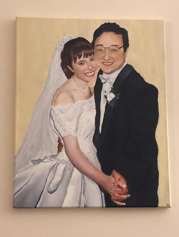 Hand painted wedding portrait of a man and a woman on a wall