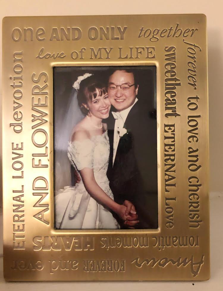 wedding photo framed in engraved gold frame
