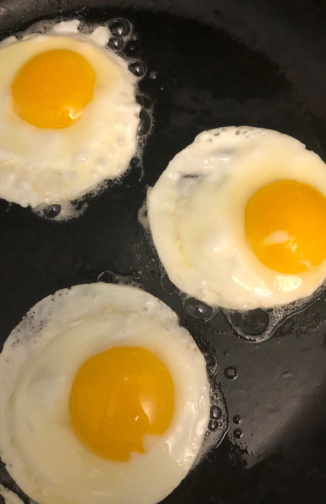 fried eggs in black cast iron pan