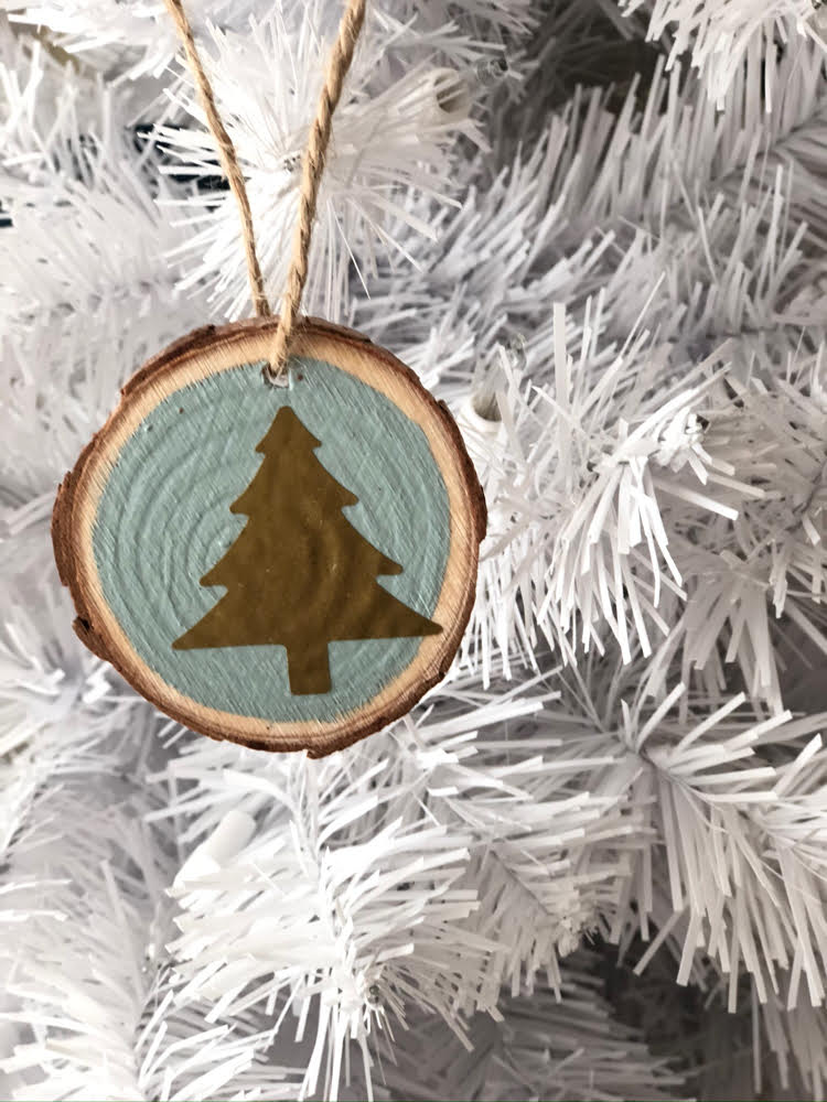 a beautiful gold and blue Christmas wood slice ornament
