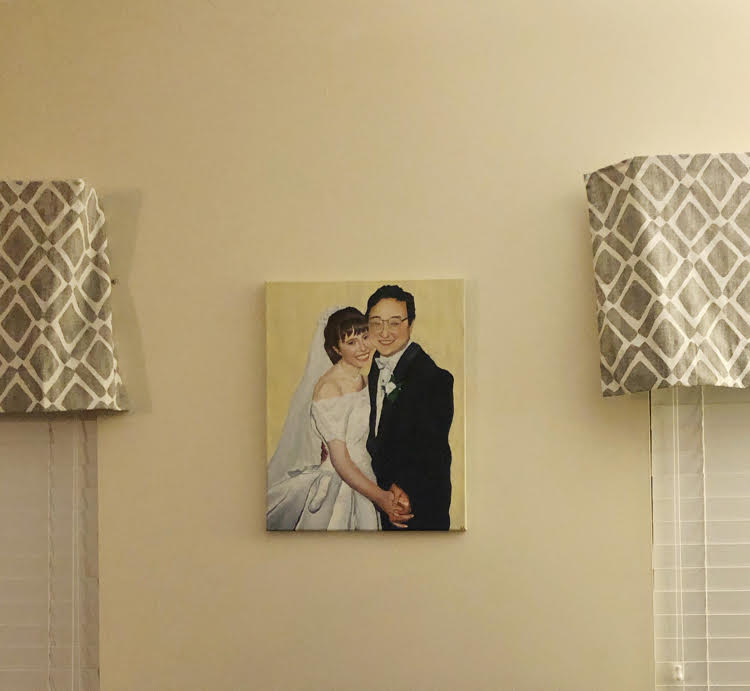 painted wedding portrait on a wall
