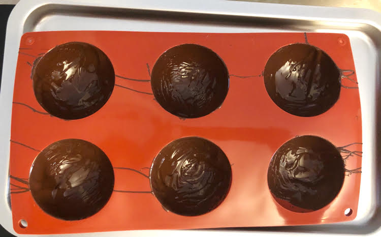 Melted chocolate in silicone hot cocoa bomb molds