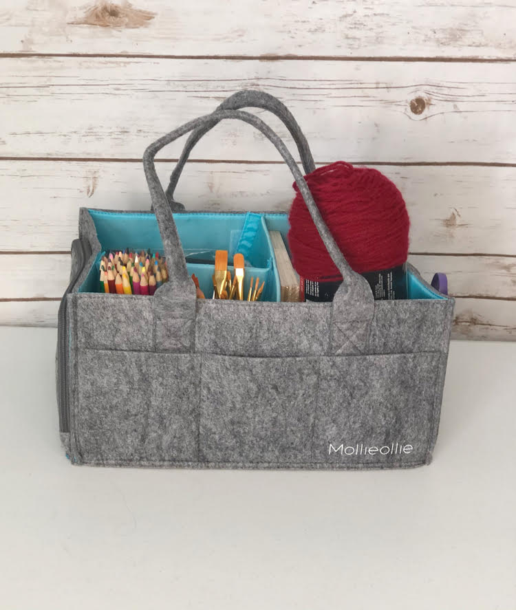 The sturdy felt Mimmo Caddy by Mollie Ollie can be used as a diaper bag or as a caddy for crafts, planner supplies, as a knitting basket, car seat organizer, etc.