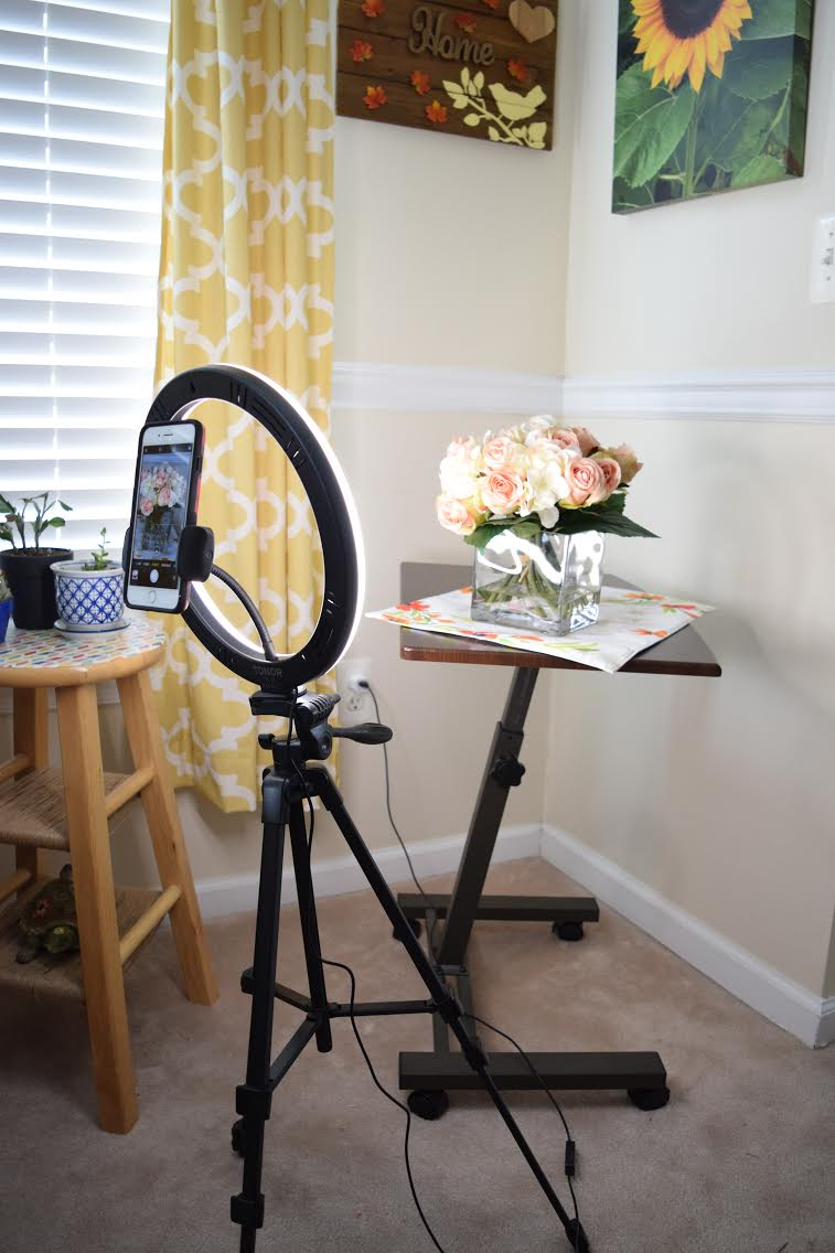mini home photo studio setup with a portable smartphone ring light setup and a rolling tablle