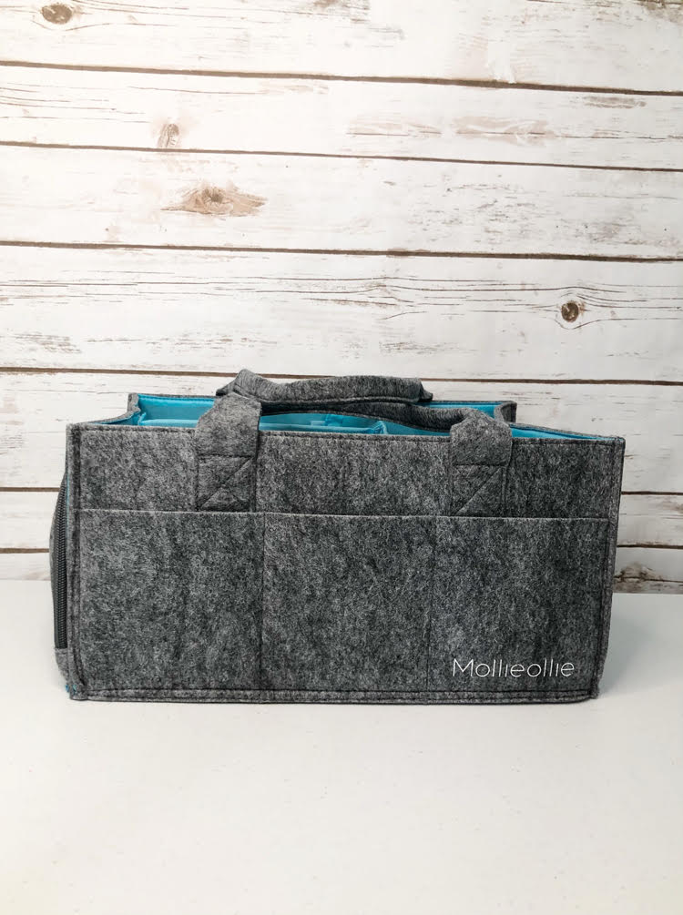 The felt Mollie Ollie Mimmo caddy, which can be used a caddy for diapers. craft or planner supplies, etc.