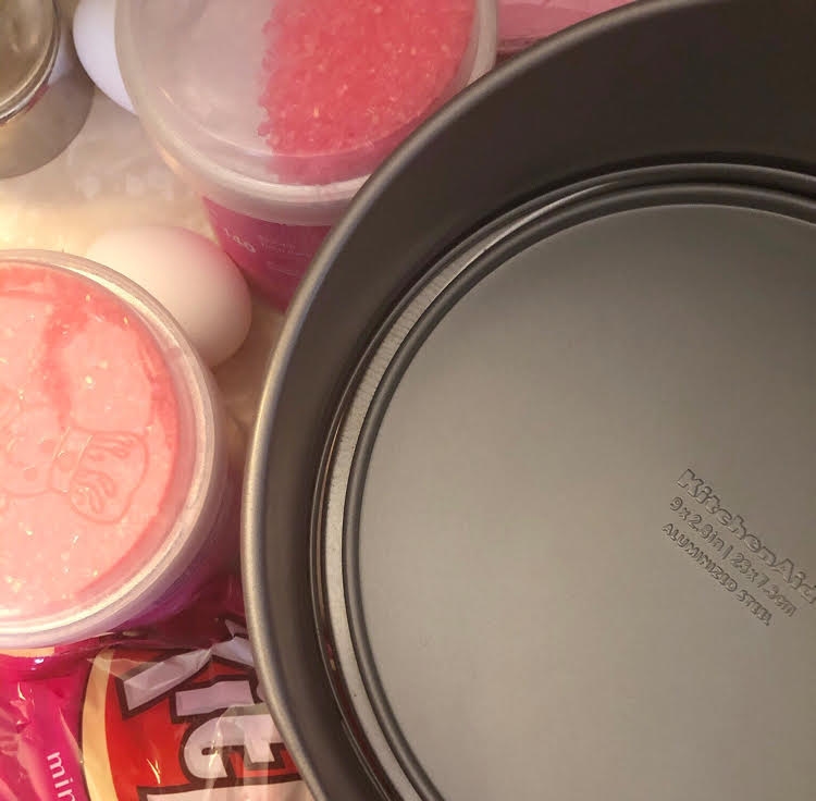 Ingredients for a pink KitKat double layer cake