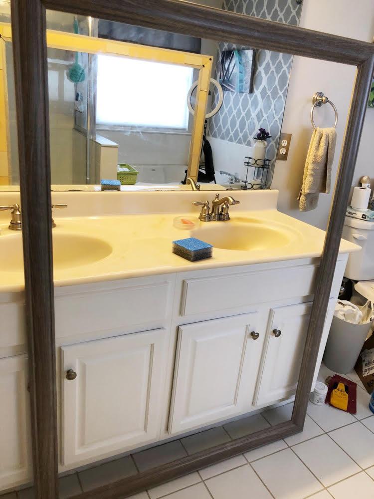 a bathroom mirror frame by MirrorChic